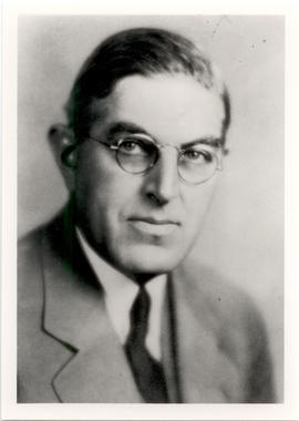 Studio portrait of Ellis Fischel.