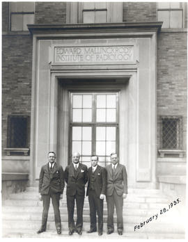 Group portrait of Glover H. Copher, Evarts A. Graham, W. H. Cole, and Sherwood Moore in front of ...