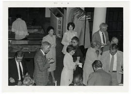 Overhead view of men and women mingling at a St. Louis Medical Society reception honoring the Bau...