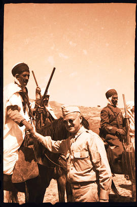 Col. Lee D. Cady shaking hands with mounted Caid El Moseri ben Moussa, Ben Hanifia, Algeria.
