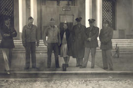 Group portrait of Col. Lee D. Cady with visitors, Grand Hotel, Bou Hanifia, Algeria.