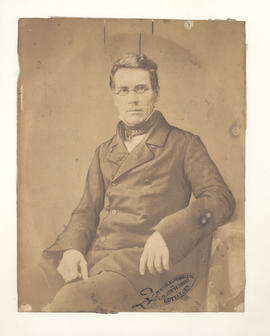 Unidentified man seated, possibly Frederick Ernst Baumgarten.