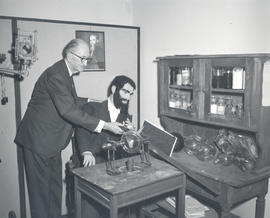 Edwin C. Ernst with a wax model of Wilhelm Roentgen, St. Louis Medical Society Library exhibit.
