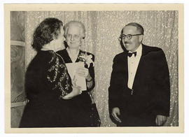 Unidentified woman, Isabel V. Brookings, and Robert A. Moore at the Cancer Research Building corn...