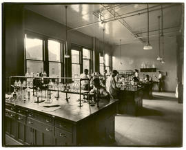 Several men at work in the Biochemistry Laboratory at Washington University School of Medicine.