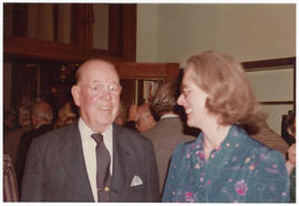 Unidentified man and Margaret Park Coxe at a St. Louis Medical Society reception honoring the Bau...