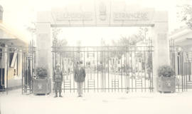 Major Joseph C. Edwards posed in front of the French Foreign Legion gate, Sidi Bel Abbes, Algeria.