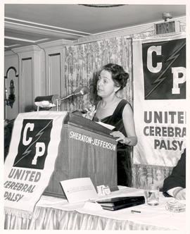 Rita Levi-Montalcini delivering an address from a podium at a Max Weinstein United Cerebral Palsy...