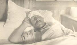 Private A.C. Walton in a hospital bed.
