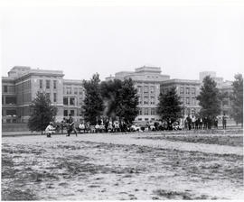 Baseball being played in front of Barnes Hospital, c.1914-1915. Barnes Hospital, facing south tow...