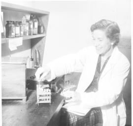 Helen B. Burch at work in the laboratory.