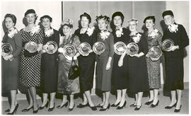 Group portrait of the St. Louis Globe-Democrat Woman of Achievement award winners for 1958.