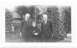 Group portrait of Father Thomas Knapp, Lucille Finette Papin, and Vilray P. Blair.