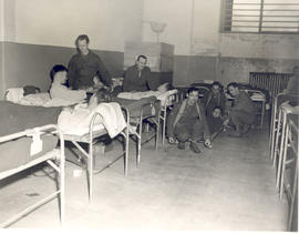 Ward scene with German POW litterbearers, 21st General Hospital, Ravenel Hospital Hospital, Mirec...