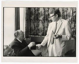Franklin E. Walton conversing with Philip R. Dodge.