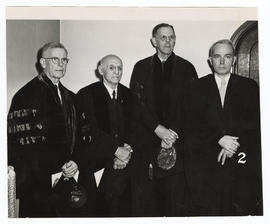 Group portrait of Ernest Goodpasture, Abraham Flexner, Edwards A. Park, and Charles B. Huggins.