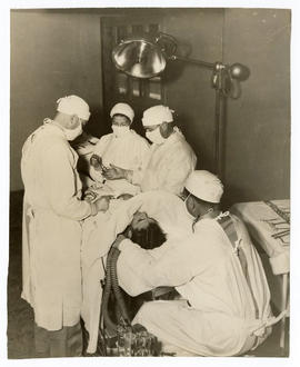 Surgeons performing an operation at Barnes Hospital.