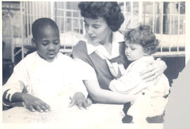 Woman, possibly a volunteer, with two young patients, St. Louis Children's Hospital.