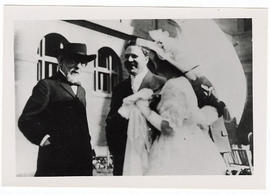 Two unidentified men and a woman with a parasol at the garden party reception after the dedicatio...