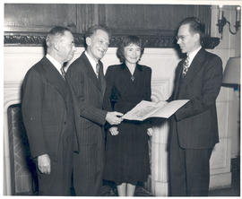 Joseph Erlanger, Carl F. Cori, and Gerty T. Cori receiving a proclamation from Carl F. Dauten at ...
