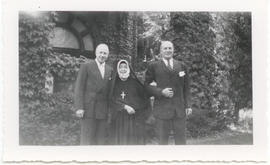 Group portrait of Lucille Finette Papin and two unidentified men.