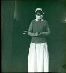 Portrait of an unidentified masked nurse.