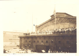 View of officers, nurses, and enlisted men on Pier 61, likely taken from the deck of the S.S. St....