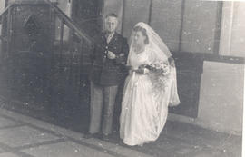 Col. Lee D. Cady escorting Verna Lachtrup to be given away in marriage to Lieutenant Richard Dana.