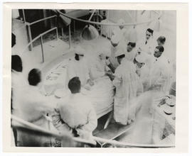 Surgeons performing an appendectomy, the first operation at Barnes Hospital.