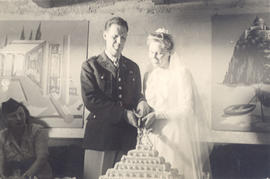1st Lt. Eleanor D. Brinkmeyer and Capt. Julius A. Spence cutting their wedding cake.
